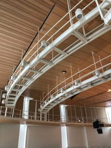 Closeup of view of curved SkyDeck™ grid panels at Penn State's new recital hall.