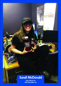Winner Sandi McDonald of SUNY New Paltz won a water bottle, an insulated mug, and a ball cap from H & H Specialties.