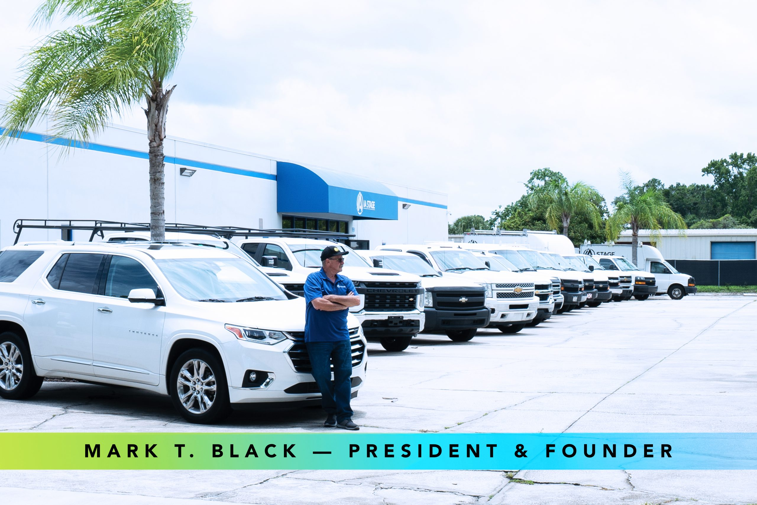 Mark Black, president and founder of IA Stage, and his fleet of company vehicles in front of the Central Florida facility.